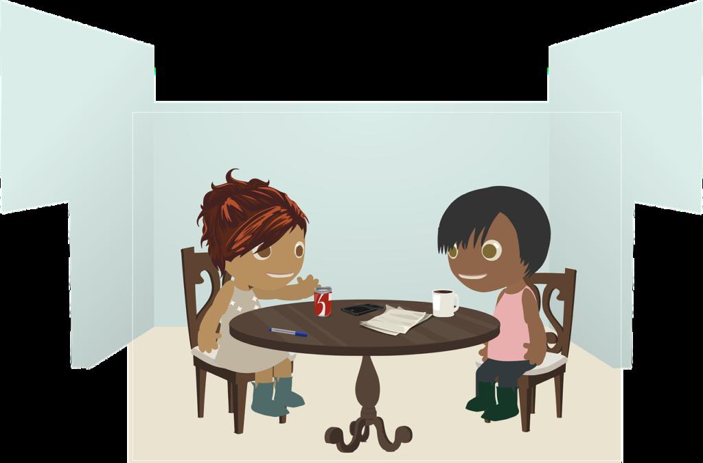椅子とテーブルについて、会話する二人の女性